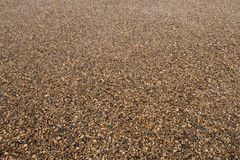 Background of fine gravel or crushed stone in perspective. royalty free stock photography