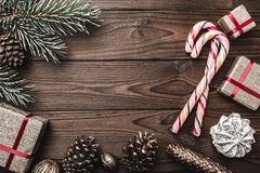 Background. Fir tree, decorative cone. Message space for Christmas and New Year. Sweets and gifts for holidays. colored candies. stock images