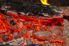 Background from a fire, conflagrant firewoods and coals Stock Images