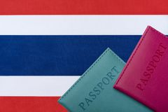 On the background of the Flag of Thailand lie a passport. Travel and tourism concept stock images