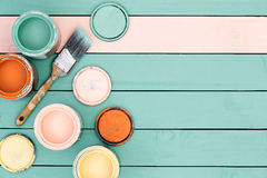 Background of floor boards, paint cans and brush Royalty Free Stock Photography