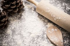 Background of flour and baking utensils with pine cones Royalty Free Stock Photography