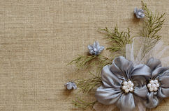 Background with a flower arrangement. Textile background with a flower arrangement in the corner Stock Photos