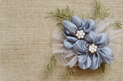 Background with a flower arrangement. Textile background with a flower arrangement in the corner Royalty Free Stock Photography