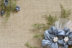 Background with a flower arrangement. Textile background with a flower arrangement in corners Royalty Free Stock Image