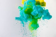 background with flowing turquoise, yellow and green smoke, isolated on grey stock photography
