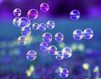 Background with flying bubbles shimmering in the sun over the summer meadow. Beautiful background with flying bubbles shimmering in the sun over the summer royalty free stock photos