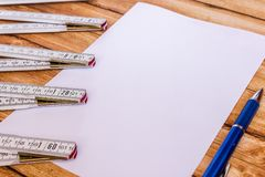 Background foldable ruler and a sheet of paper Stock Image