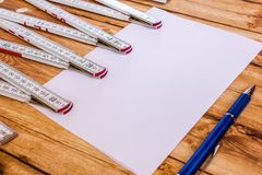 Background foldable ruler and a sheet of paper Stock Photo