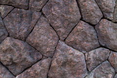 Background of folded even natural stones of red-brown color bonded Stock Images