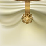 Background with folds of fabric and gold brooch. Unusual background with folds of fabric and gold brooch Stock Photo