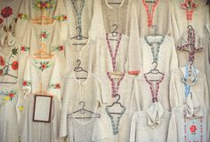 Background with folkloric ornaments, textiles on women`s suits of hats, hanging for sale. Specifically for the area of Kiev, Ukra. Ine Royalty Free Stock Photo