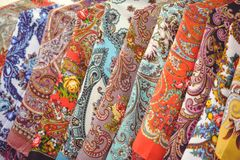Background with folkloric ornaments, textiles on women`s suits of hats, hanging for sale. Specifically for the area of Kiev, Ukra. Ine Royalty Free Stock Image