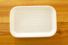 Background for food. White tray on the wooden table Royalty Free Stock Image