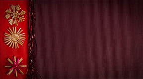Background For Christmas Greeting Card- Holiday Straw Decoration, Red And Claret Textured Paper Royalty Free Stock Photo