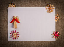 Background For Christmas Greeting Card- Holiday Straw Decoration, Red And Claret Textured Paper Royalty Free Stock Photos