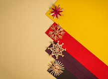 Background For Christmas Greeting Card- Holiday Straw Decoration, Red And Yellow Color Textured Paper Royalty Free Stock Image
