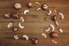 Background from Forest Mushrooms on the Wooden Table.Top View Stock Photography