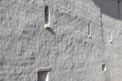 Background in the form of an old white wall of an ancient monastery stock image