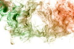 Background in the form of a pattern of colored green and red smoke in the shape of a hole, similar to a mystical ghost or an. Animal of a terrible kind on a royalty free stock photo