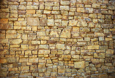 Background in the form of a wall from a granite Stock Image