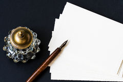 Background with fountain pen, inkwell, papers. Fountain pen, inkwell, letter with space for your logo or text stock image