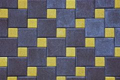 Background of a fragment of a square paving slab on the road Stock Image