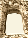 Background frame of ancient ruin arc window sepia. Background frame of ancient ruin arc window in sepia tonning Royalty Free Stock Images