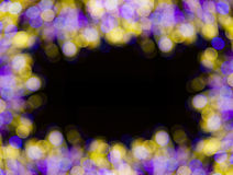 Background frame with bokeh lights on black Royalty Free Stock Photos