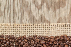 Background frame  of coffee beans on bagging. Royalty Free Stock Photo