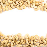 Background frame made of peanuts. Frame made of peanuts over white background Royalty Free Stock Photo