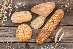Background of fresh bread and bakery on an old vintage planked w Royalty Free Stock Photos