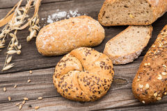 Background of fresh bread and bakery on vintage planked w Royalty Free Stock Images