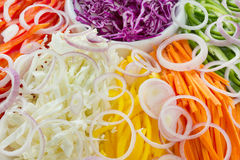 Background of fresh cut vegetables. Carrot, cabbage, bell peppers, onion Stock Photography