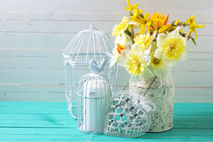 Background with fresh daffodils  and decorative heart Royalty Free Stock Photography