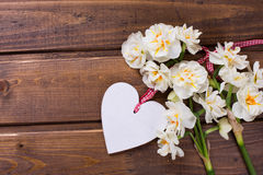 Background with fresh daffodils and heart Royalty Free Stock Images