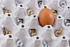 Are there anymore eggs 2. Background with a fresh egg, silver and gold question marks inside an egg tray. Concept for success royalty free stock photo