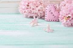 Background with fresh flowers hyacinths  and decorative heart Royalty Free Stock Photo