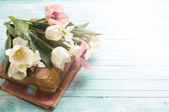 Background with fresh flowers and  old books Royalty Free Stock Image