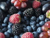 Background of fresh fruits and berries. Ripe blackberries, blueberries, plums and raspberries. Mix berries and fruits. Top view. Background berries and fruits stock photo
