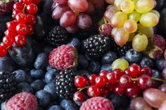 Background of fresh fruits and berries. Ripe blackberries, blueberries, plums and raspberries. Mix berries and fruits. Top view. B. Ackground berries and fruits royalty free stock photography