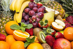 Background of fresh fruits. Bunch berry, banana royalty free stock photography
