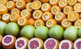 Background of fresh fruits of pomegranate oranges kiwi Royalty Free Stock Image
