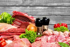 Fresh Raw Meat Background with vegetables. Background fresh meat raw group objects market Stock Photos