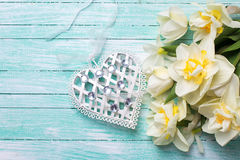 Background with fresh narcissus and decorative heart Stock Photo