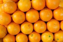 Oranges. Background of fresh oranges fruit on the market Royalty Free Stock Photos