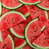Background of fresh ripe watermelon slices. A Background of fresh ripe watermelon slices stock image