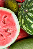 Background of fresh ripe watermelon and slices Royalty Free Stock Photos