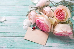 Background with fresh roses flowers and empty tag Royalty Free Stock Images