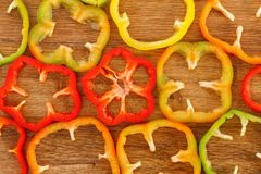 Background of fresh sliced bell peppers. On wooden cutting board Stock Photography